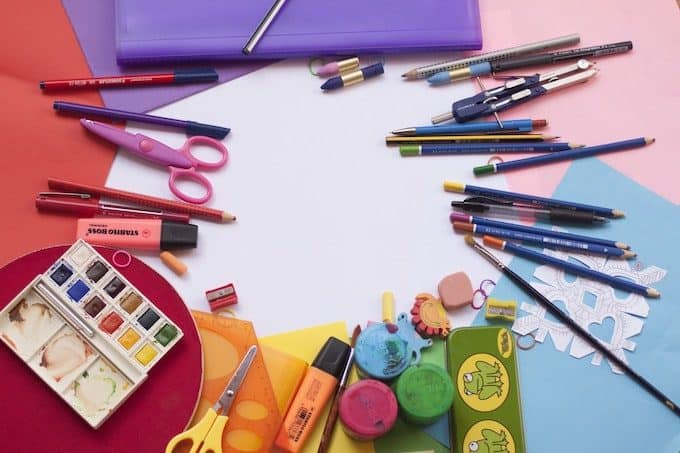 Colorful art supplies spread out on a table