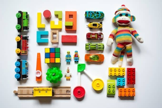 Colorful kids toys laid out on a white surface