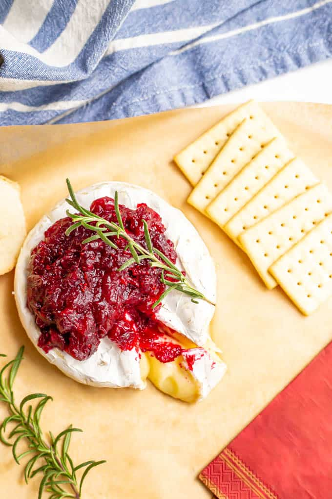 Holiday cheese appetizer served with crackers and cocktail napkins