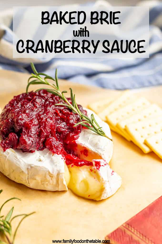 Baked brie with cranberry sauce is a quick and easy appetizer that's perfect for holiday parties and entertaining! Just 2 ingredients and ready in 10 minutes! #bakedbrie #appetizer #holidayfood #partyfood #entertaining #easyrecipe