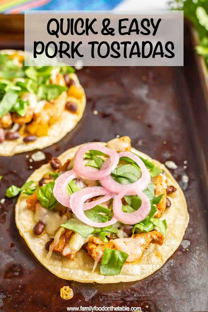 Quick and easy pork tostadas with green chilies, black beans and cheese on baked, crispy corn tostadas are a delicious dinner that's ready in about 15 minutes! #porkrecipes #easydinner #porkdinner #tostadas #familydinner