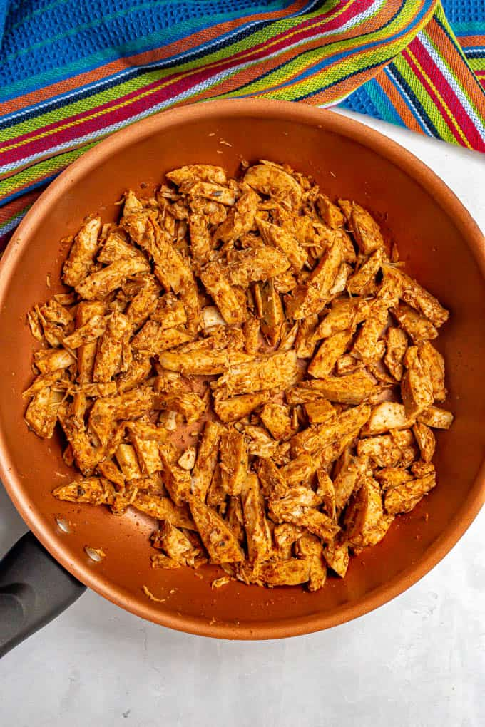 Leftover Thanksgiving turkey strips warmed with taco seasoning in a large skillet