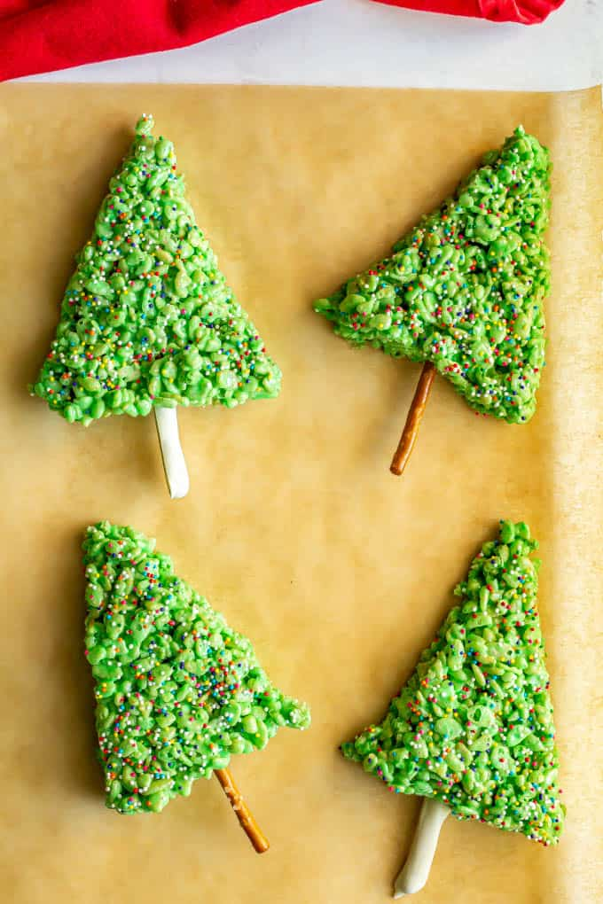 Rice Krispies Christmas trees on a piece of parchment paper