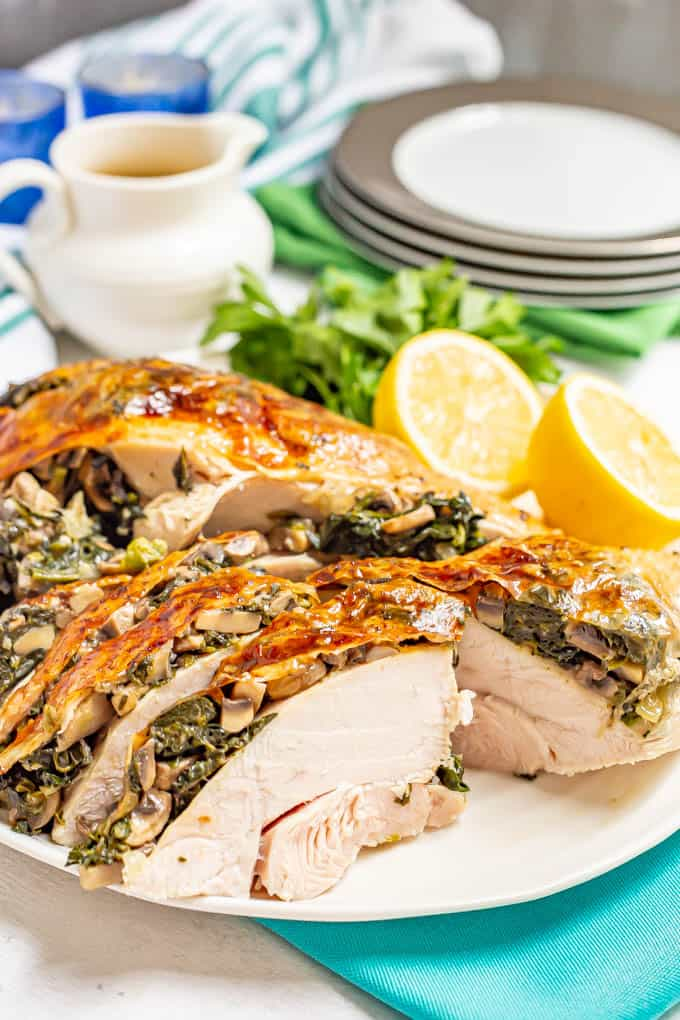 A roasted sliced stuffed turkey breast with spinach and mushrooms,