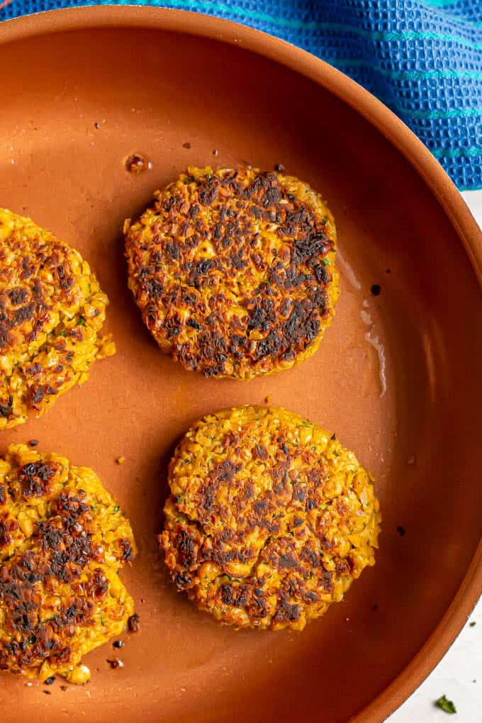 Easy chickpea burgers being cooked in a pan