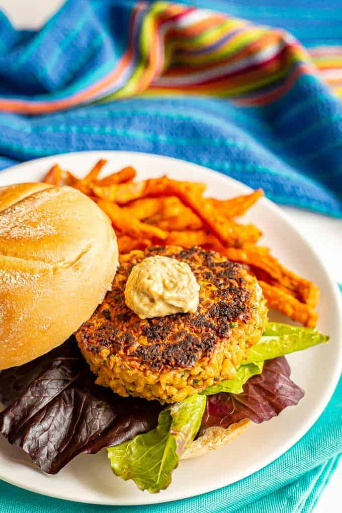 Easy chickpea burgers come together quickly, are sturdy while cooking and have delicious flavor! Add your favorite toppings and use these vegetarian burgers for burgers, wraps, on salads or in grain bowls at lunch or dinner. #chickpeas #veggieburger #vegetarianrecipes #burgers #healthyeating #healthyrecipes