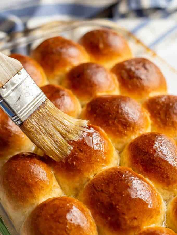 These easy homemade dinner rolls come out perfectly soft, ridiculously tall and gorgeously golden brown every time. And they are ready, start to finish, in just an hour! #dinnerrolls #breads #breadlove #bakinglove