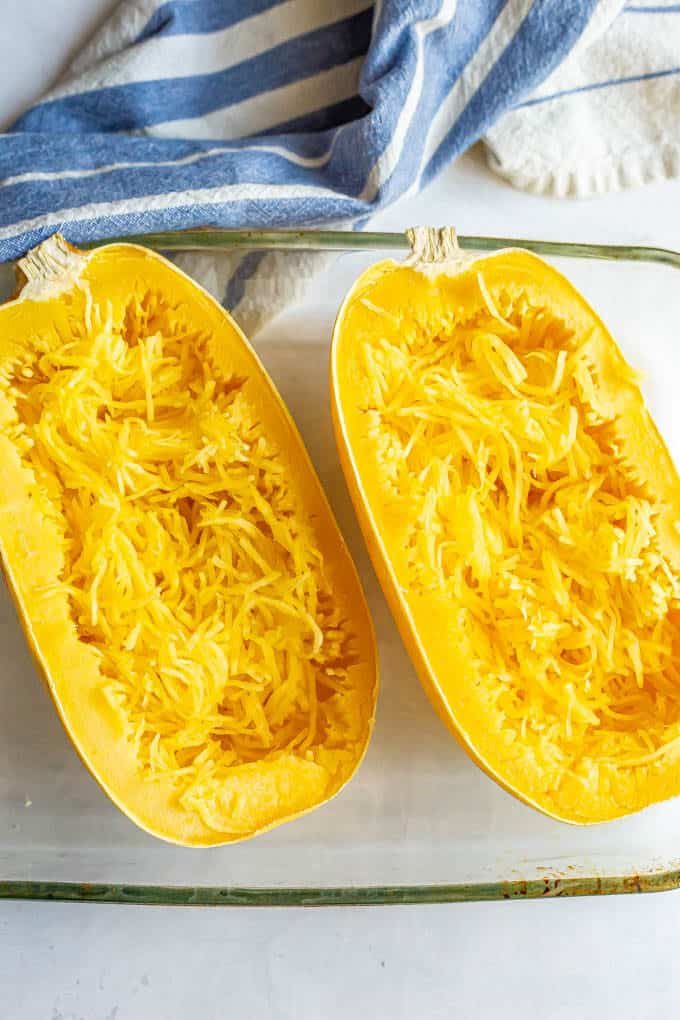 Microwave spaghetti squash halves after cooking and being pulled into strands