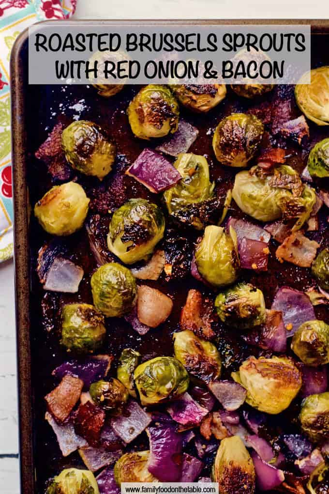 Brussels sprouts are roasted with bacon and chunks of red onion for a super flavorful veggie side dish that everyone will love! #brusselssprouts #veggiesides #sidedish #roastedveggies