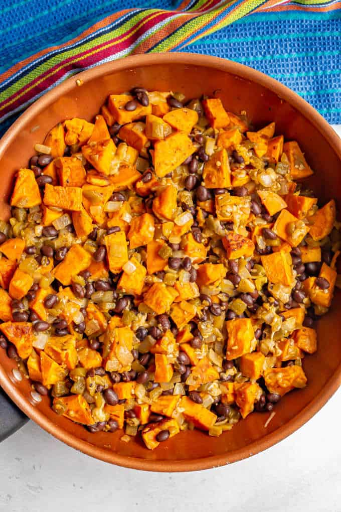 Sweet potato and black bean mixture mixed in pan for stuffing into enchiladas