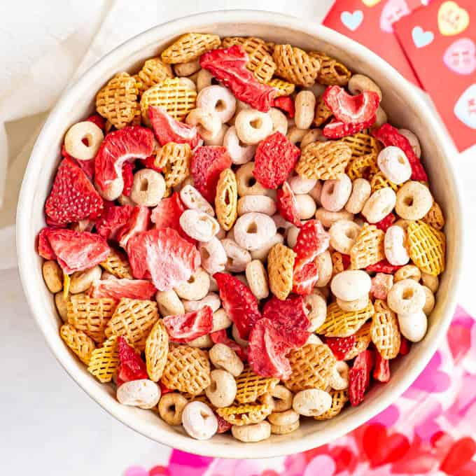 A healthy Chex mix with pink cereal and dried strawberries