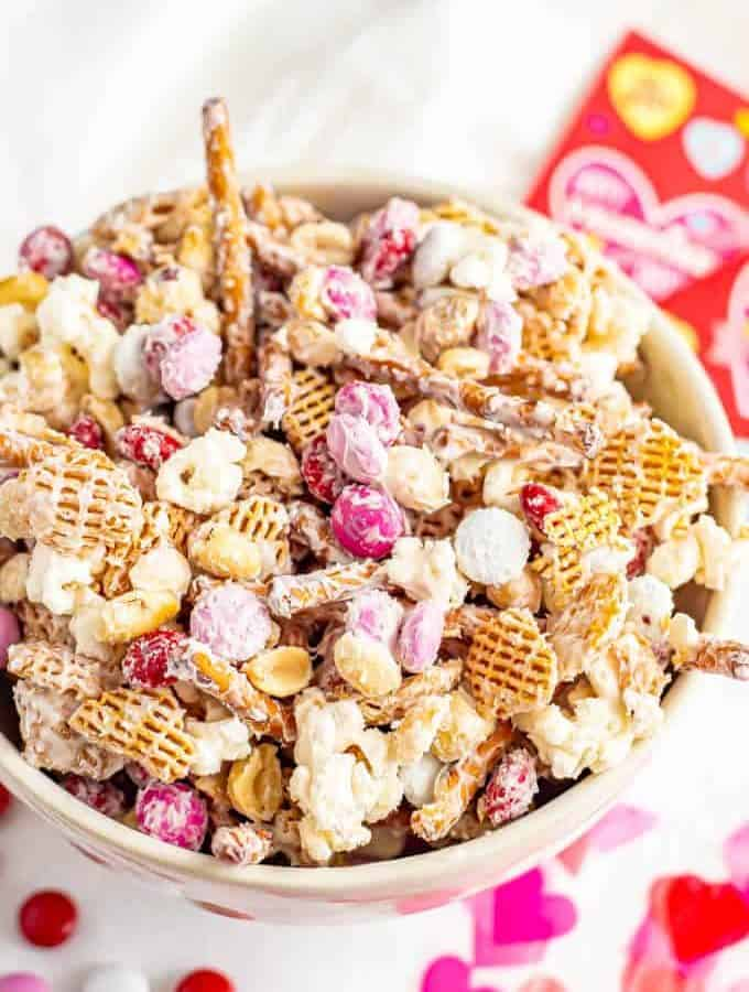 A bowl full of Cupid's Crunch snack mix with Valentine's M&Ms