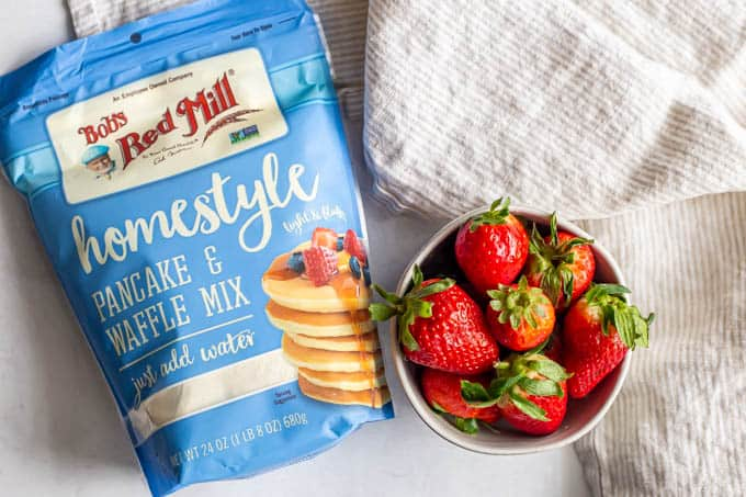 Bob's Red Mill pancake mix and a bowl full of strawberries