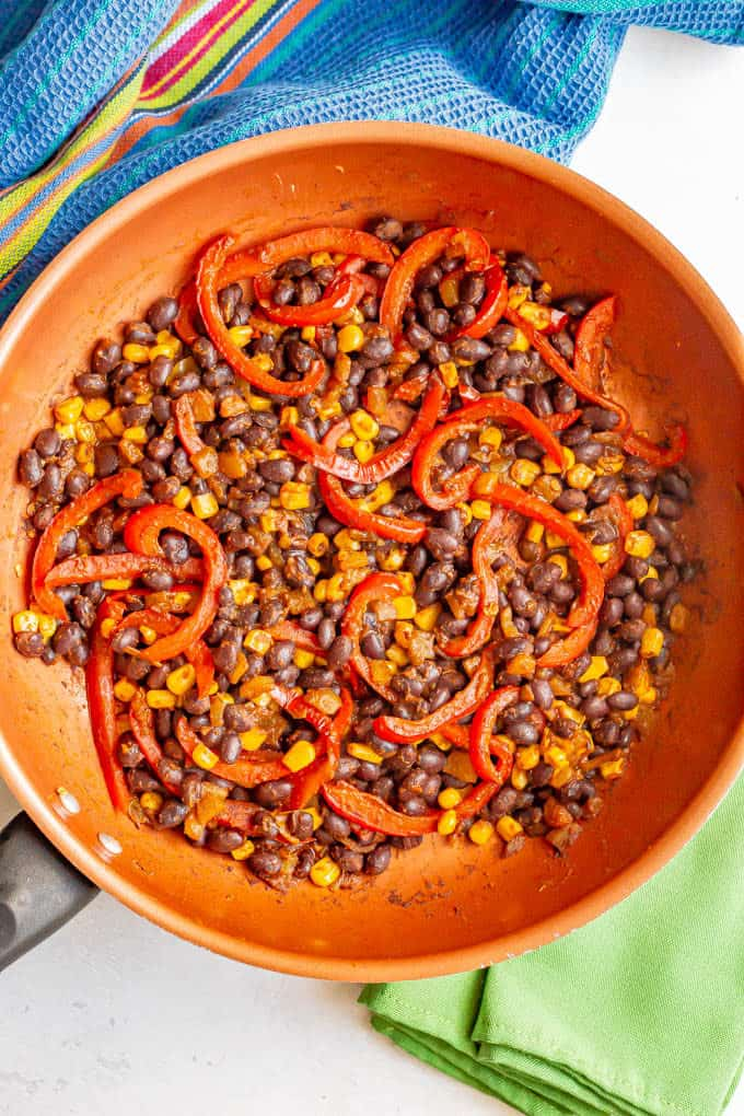Black beans, red pepper and corn cooked in a copper skillet