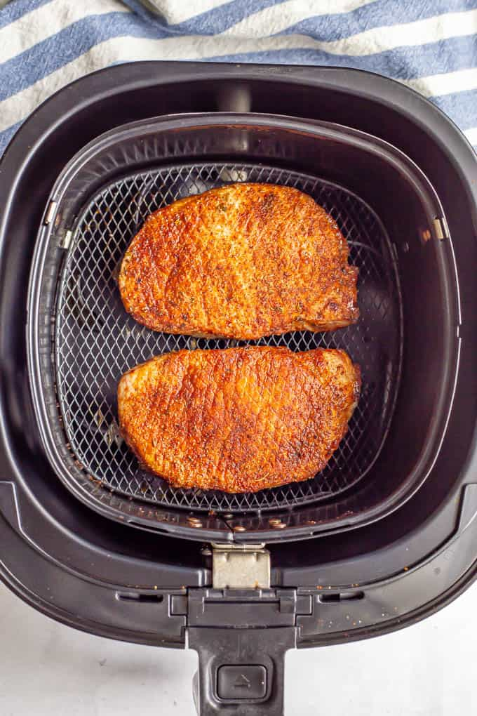Pork chops in an Air Fryer after cooking