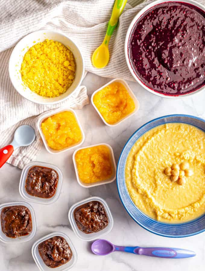 Baby food purees in different bowls and containers