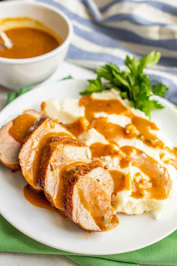 Sliced pork served with mashed potatoes and gravy