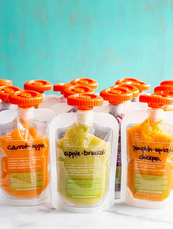 A collection of fruit and veggie baby squeeze pouches in plastic labeled pouches