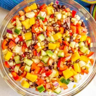 A colorful fresh vegetable salad in a glass bowl
