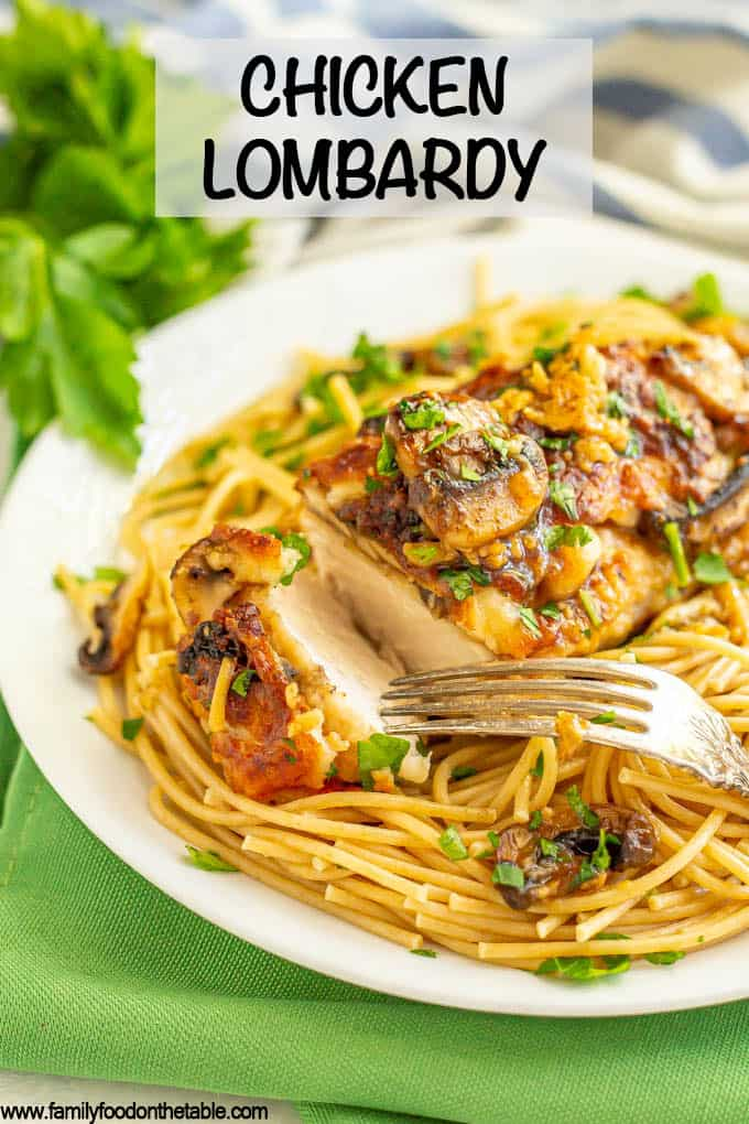 Roasted chicken with mushrooms, cheese and wine sauce over spaghetti noodles