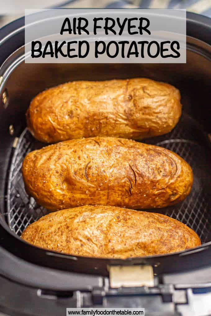 Three potatoes in an Air Fryer tray after baking