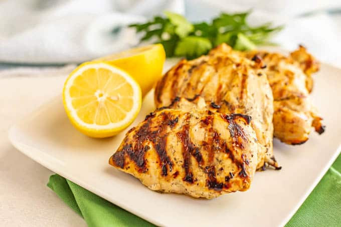 Chicken breasts with grill marks served on a white platter