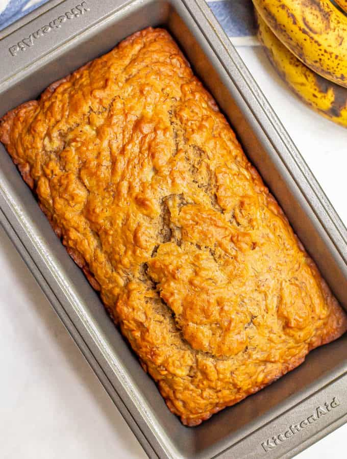 Baked loaf of banana bread in a bread pan