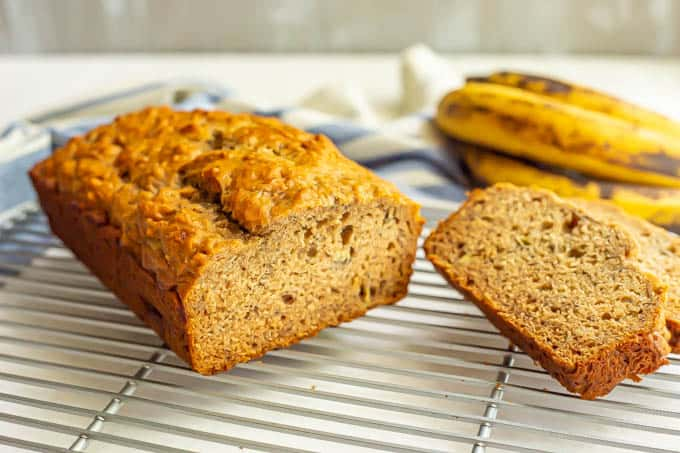 Healthy banana bread sliced on a cooling rack