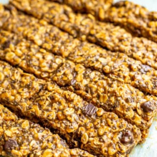 Homemade healthy granola bars cut into slices on a pice of parchment paper