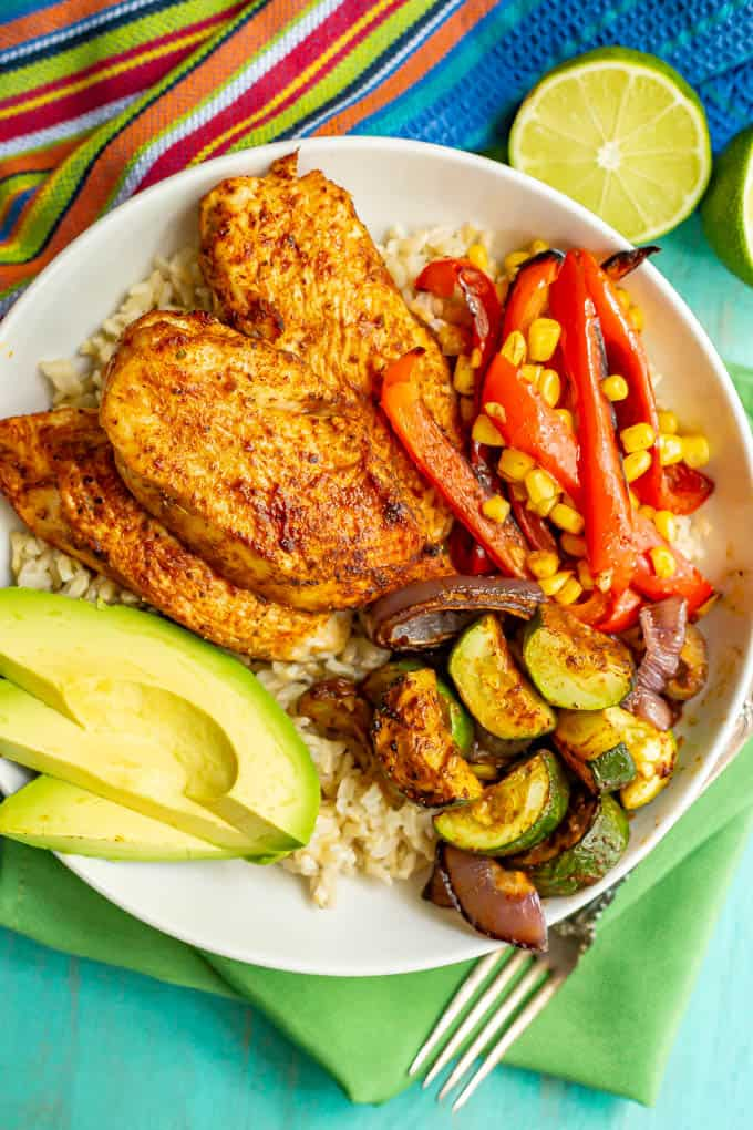Rice bowl with chicken strips, roasted veggies and avocado slices