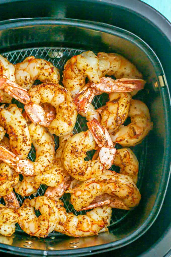 Cooked shrimp with the tails on after cooking in an Air Fryer