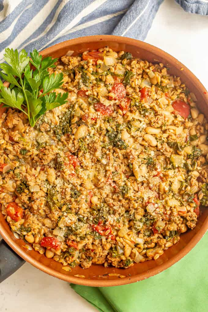 Turkey sausage and farro skillet with white beans, kale and tomatoes