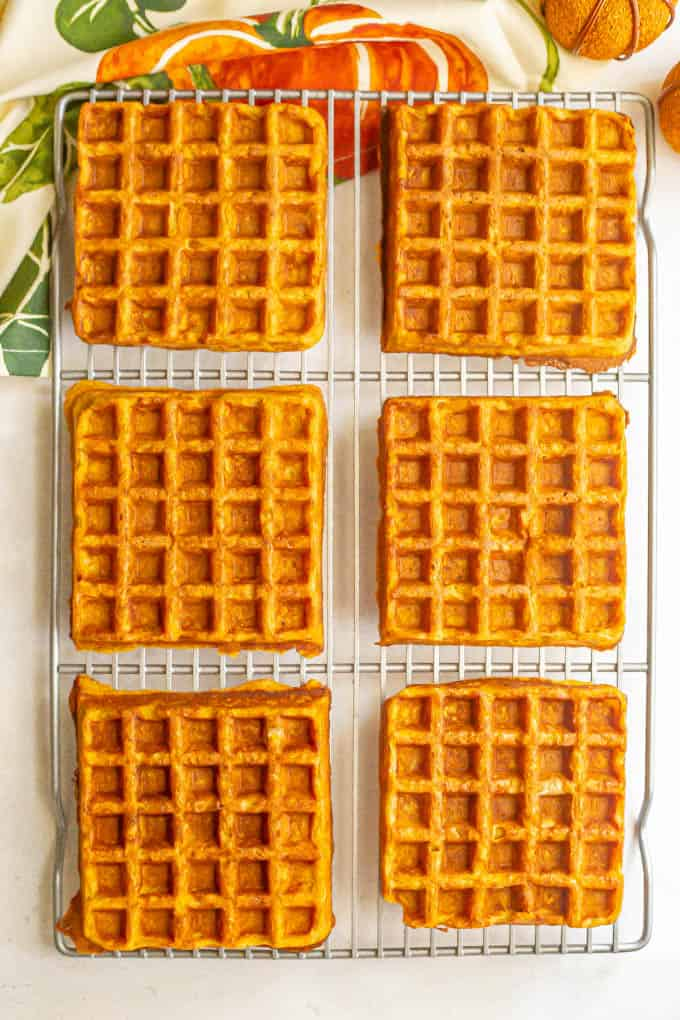 Six large square whole wheat pumpkin waffles on a cooling rack