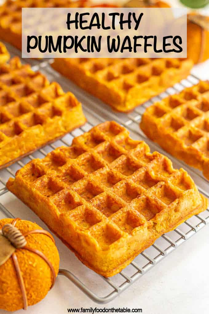 Large square pumpkin waffles on a cooling rack with a text box on top