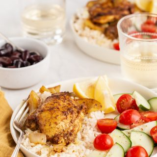 Oven roasted chicken shawarma served over rice with fresh veggies
