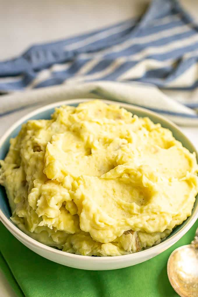 Creamy mashed potatoes served in a white and blue bowl