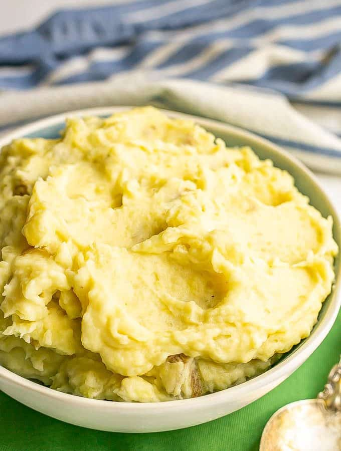 Close up of creamy Yukon mashed potatoes in a blue and white serving bowl