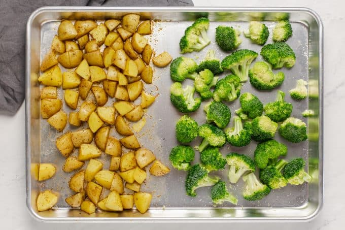A sheet pan of roasted potatoes and broccoli