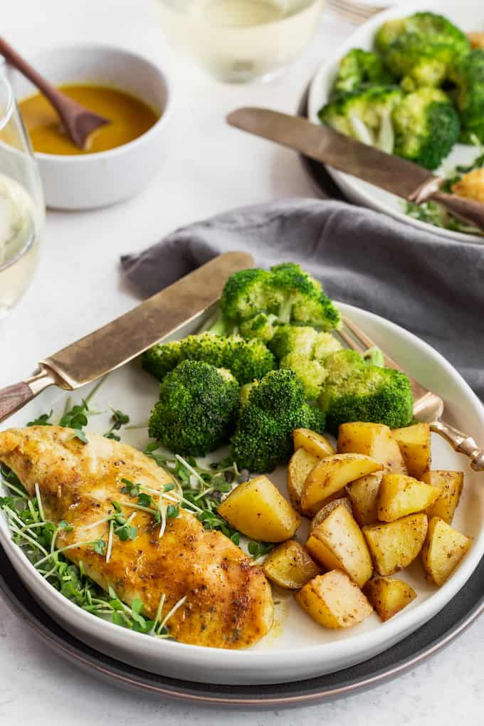 A dinner plate of honey mustard chicken with roasted veggies