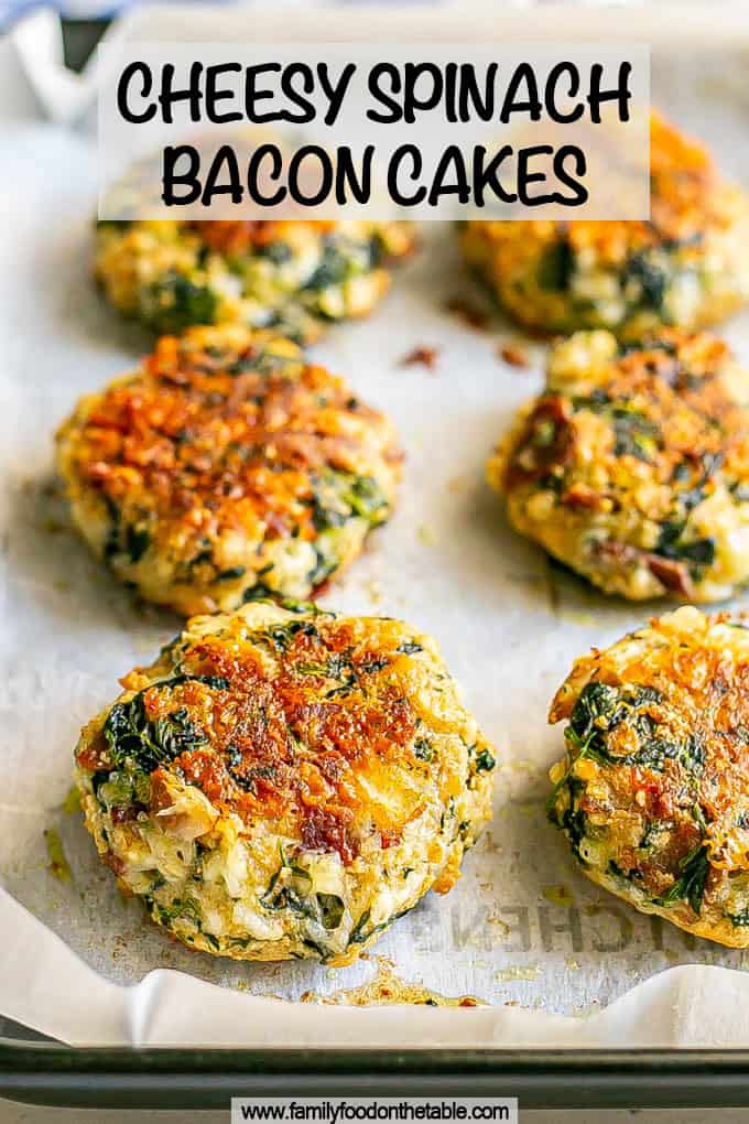 Baked golden brown cheesy spinach cakes with bacon on parchment paper on a baking pan with a text overlay on top