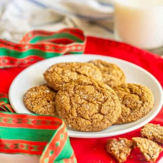 A plate of ginger snaps with holiday ribbons and napkins nearby