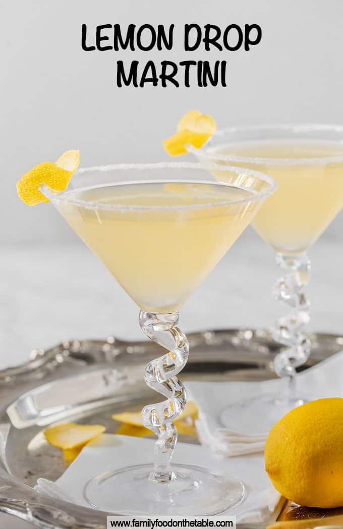 Two lemon drop martinis on a silver tray with a text box on top