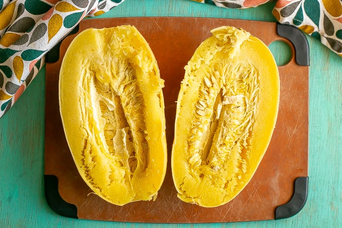 A cooked halved spaghetti squash before the seeds and pulp have been removed