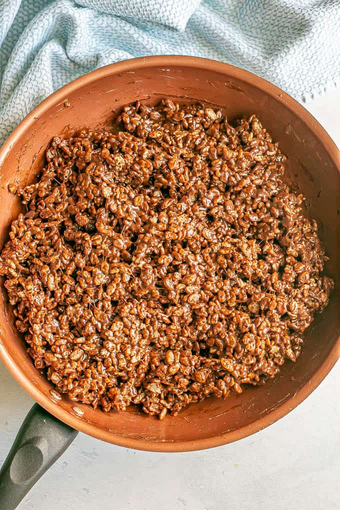 Chocolate Rice Krispies in a copper pan after being mixed together