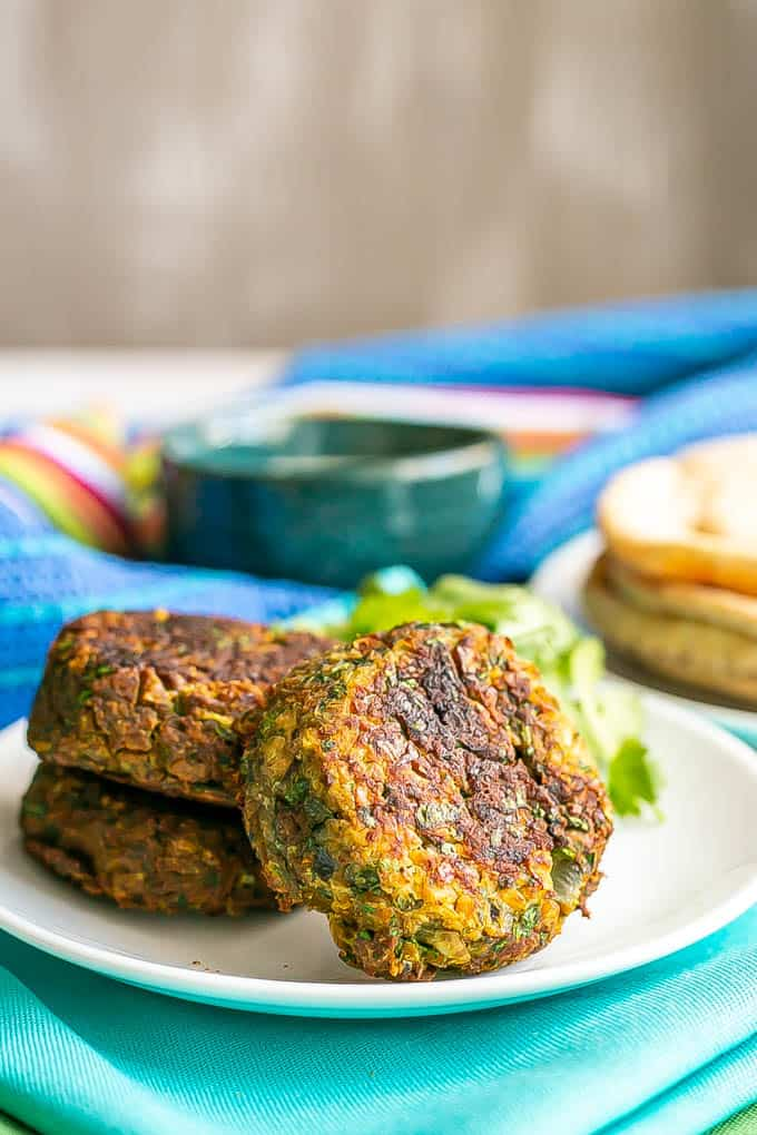 A trio of baked falafel patties on a white plate