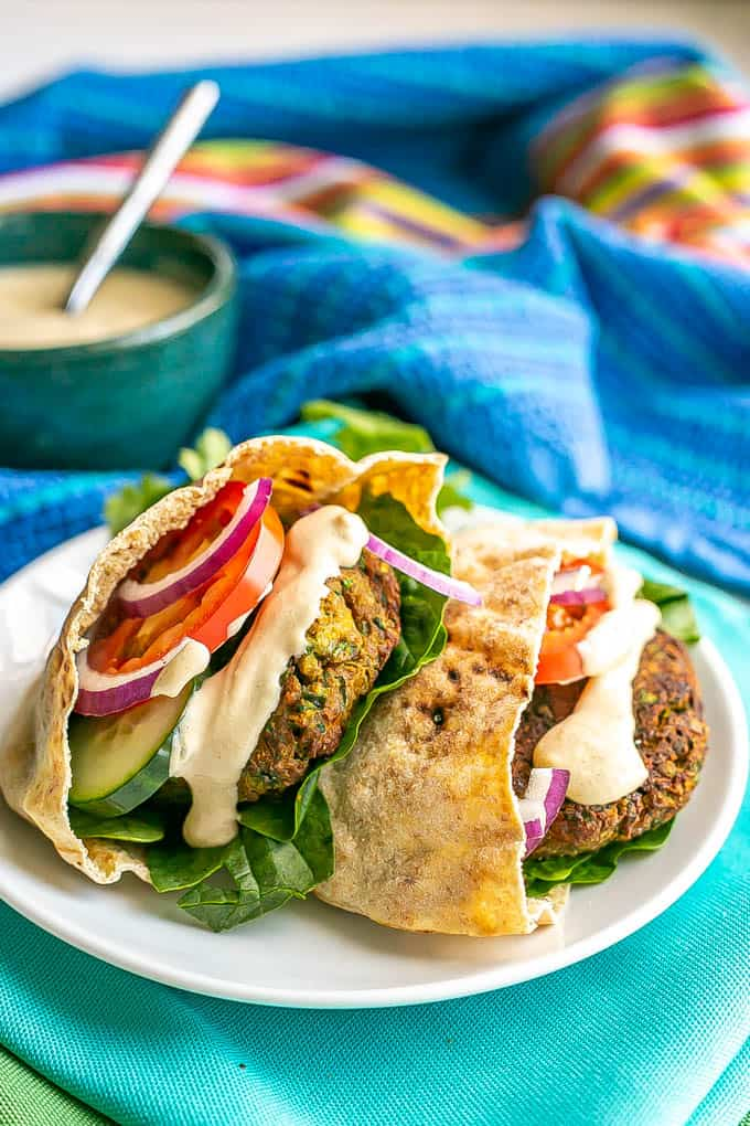 Baked falafel stuffed into pita halves along with some fresh veggies and topped with a tahini sauce