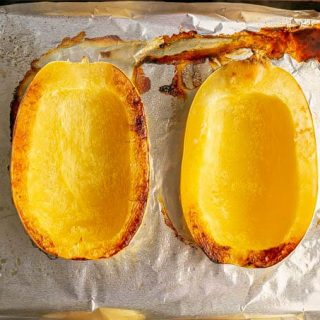 Two spaghetti squash halves after roasting in the oven