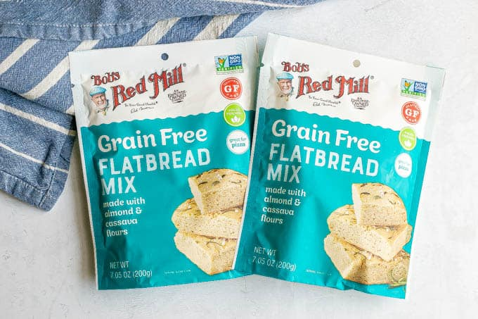 Two pouches of Bob's Red Mill flatbread mix on a counter