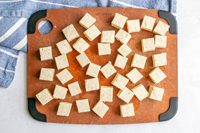 Pieces of cubed tofu on a cutting board
