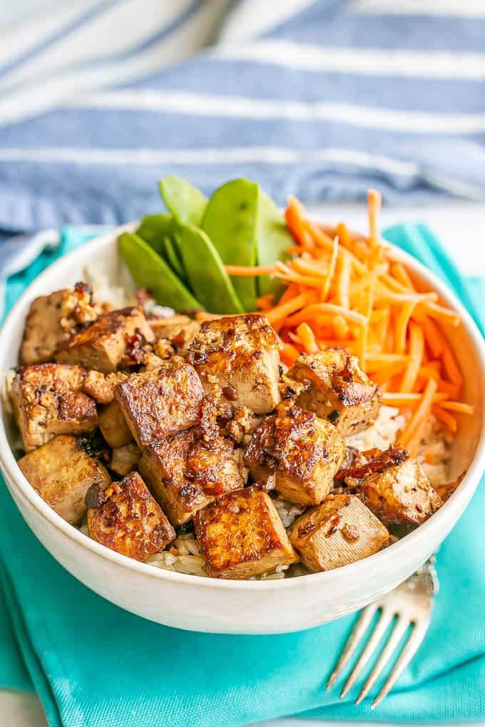 Marinated crispy tofu in a rice bowl with veggies